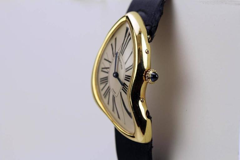 "This Cartier ""Crash"" is a limited edition of 400. The design is a reissue of the iconic Cartier ""Crash"" watch of the 1960's. There are a lot of stories surrounding this watch and its original beginnings. This watch is on a Cartier strap and has the"