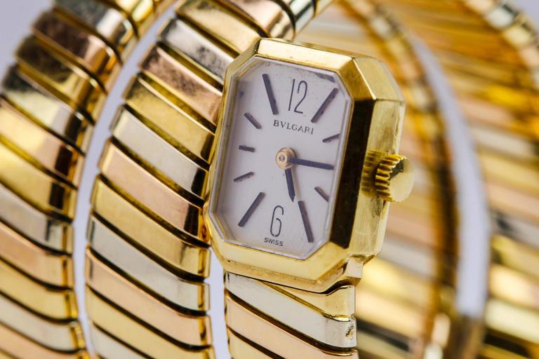 Bulgari Tri-colored 18k gold lady's Tubogas with a emerald cut shaped case.