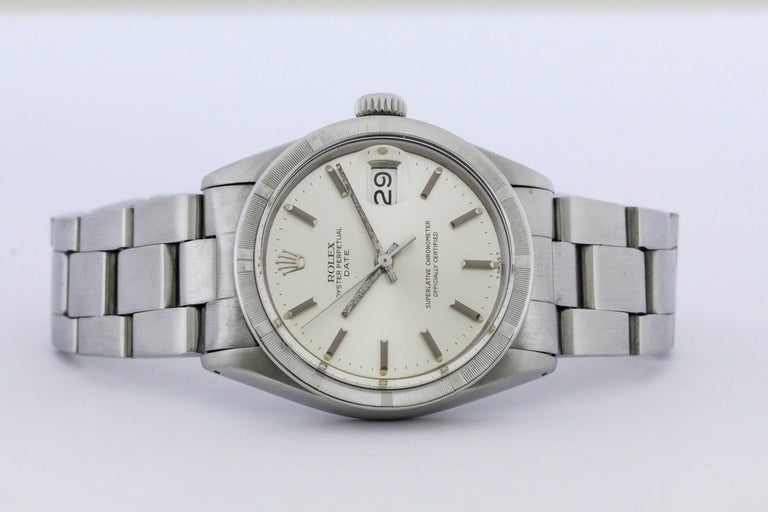 Rolex Date reference 1501 with engine-turned bezel, silvered dial,and on an oyster Rolex bracelet. Circa 1970