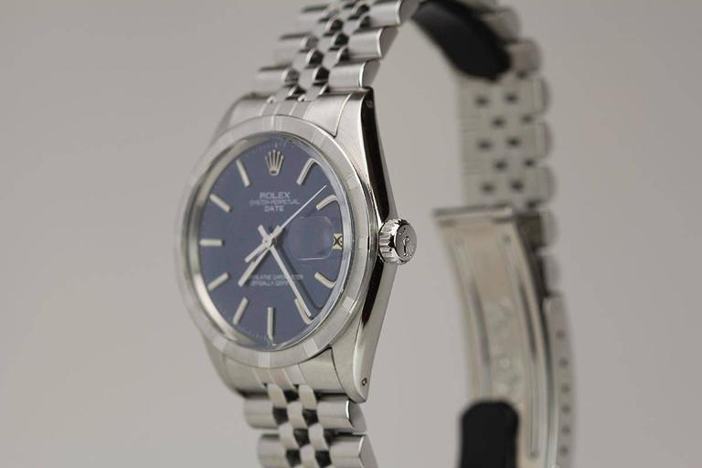 Rolex Date reference 1501 with engine-turned bezel, blue satin dial,and on a jubilee Rolex bracelet. Circa 1967.