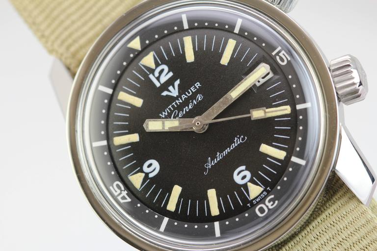 "Wittnauer Geneve diver's watch with an automatic caliber 53, 17-Jewel movement.  This has a nice patinated dial, white tracking,  dual ""w"" crowns,  and is on a modern nylon military strap. circa 1960's"