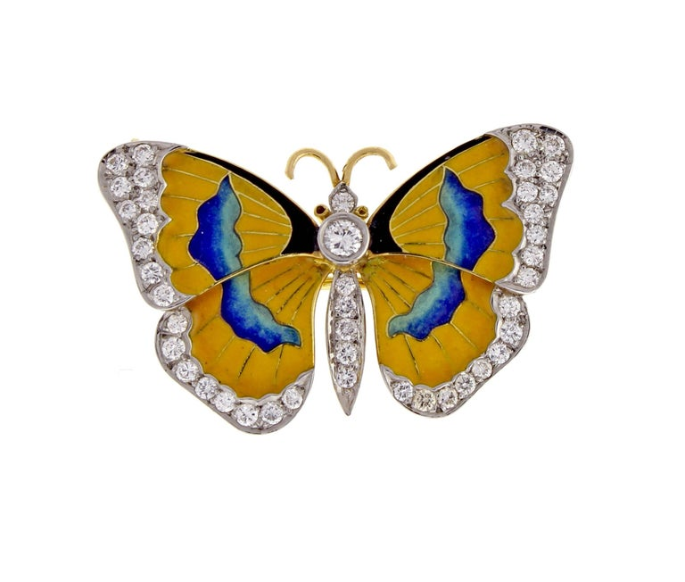 From Van Cleef & Arpels, a stunning enamel and diamond butterfly brooch. The 18 karat yellow gold brooch easily converts to a necklace. The brooch is set with 43 brilliant diamonds weighing approximately .70 carats and finished with vibrant hand