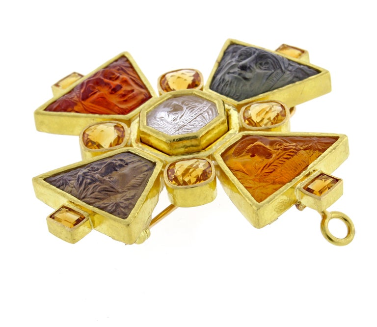 A rare and highly collectible 19 karat carved glass cameo and citrine brooch/pendant by Elizabeth Locke. Each of the five cameos are inspired from Italian architect Pirro Ligorio's Monsters of Bomarzo park. 2 1/4 inch square