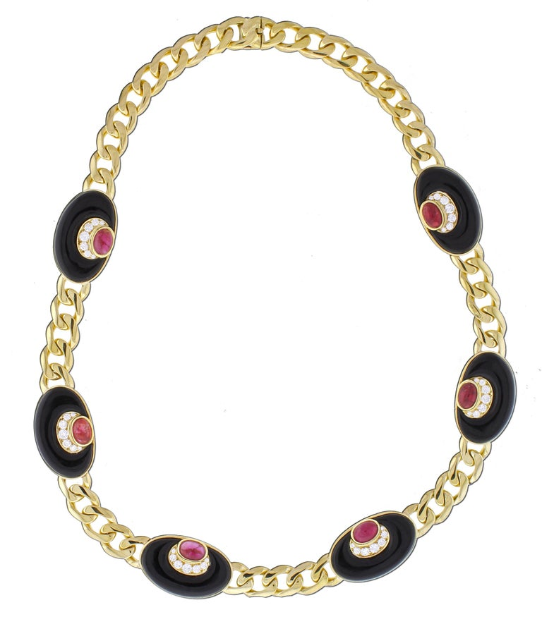 From Bvlgari, a stunning diamond, black onyx and ruby necklace.  The necklace is designed with eight sections of oval carved partially domed black onyx with with a crescents of diamonds and a cabochon rubys. The 42 diamonds weigh approximately 1.50