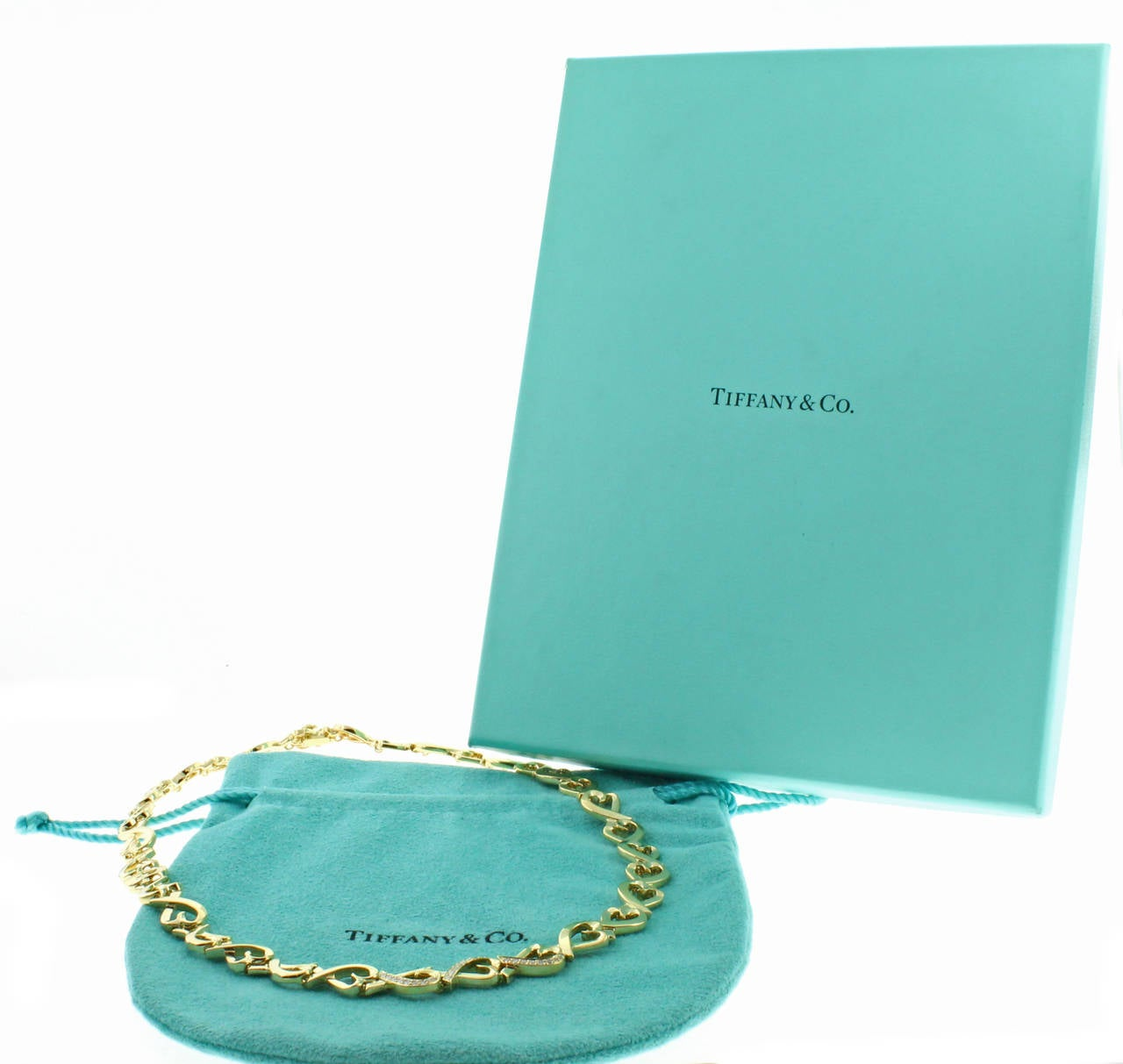 Tiffany & Co. Paloma Picasso Diamond Gold Loving Heart Necklace In Excellent Condition For Sale In Washington, DC