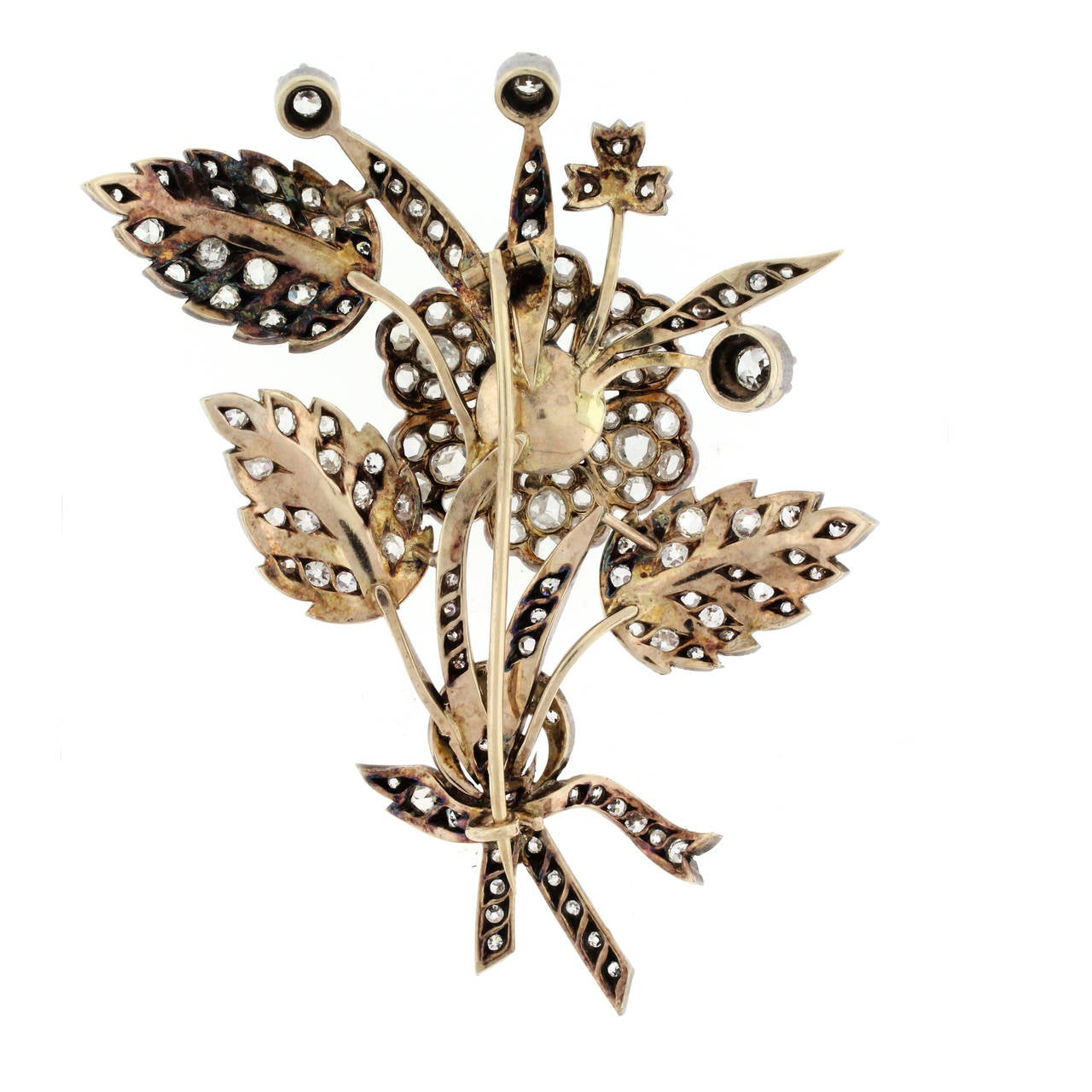 """En Tremblant"" floral brooches were popular in the 19th century. The central flower is mounted on a spring and trembles as the wearer moves.