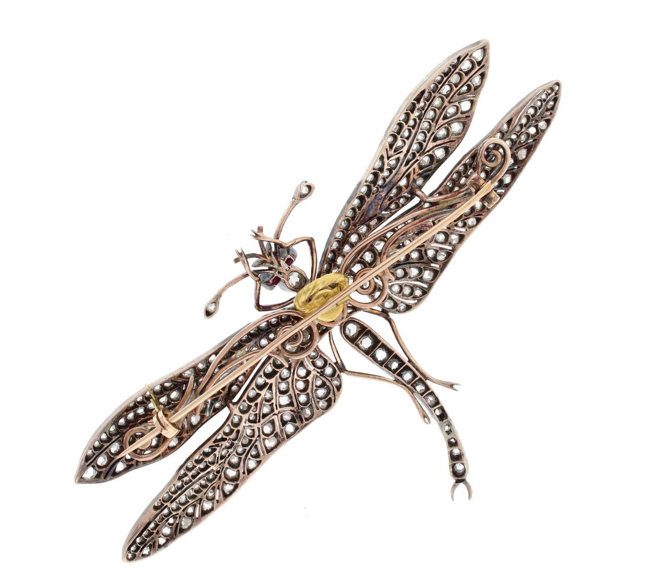 The Victorians had a great interest in nature inspired themes.The dragonfly was know to symbolizes immortality, regeneration and good luck.  Two hundred and eighty rose and old european cut diamonds weighing 6.5 carats are set in silver over gold