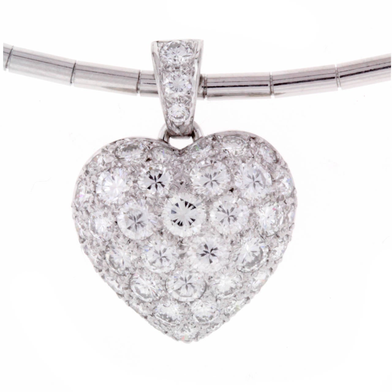 "18kt w/g Cartier diamond pave puffed heart. Set with 40 brilliant cut diamonds weighing 2.00 carats with Cartier 16"" collar necklace."