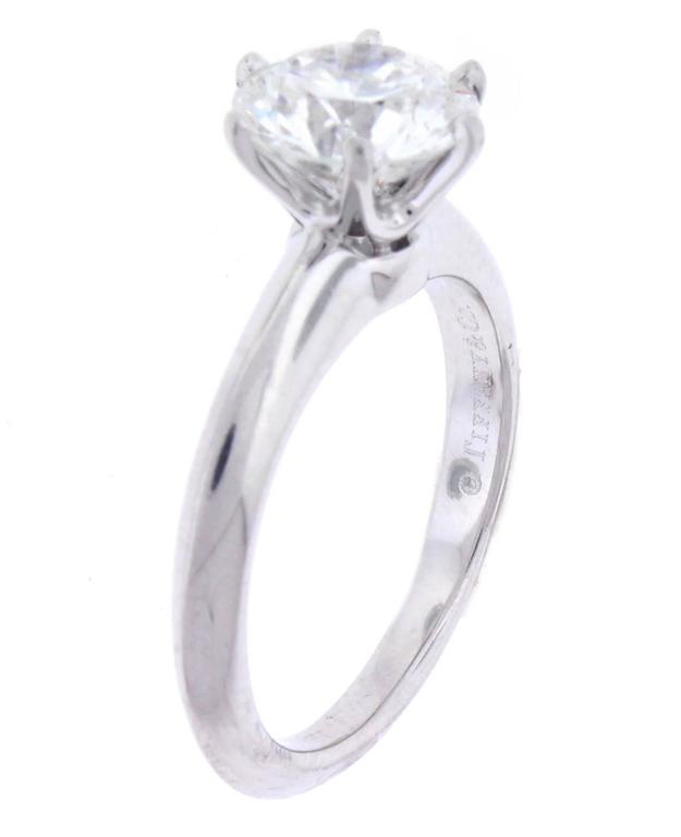 A shimmering Diamond set in Tiffany & Co classic platinum setting. The Tiffany laser inscribed diamond weighs 1.64 carat, The diamond is I color ,VVS1 clarity with excellent polish, symmetry and cut.