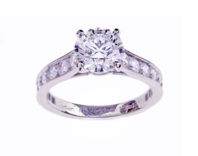 The Cartier solitaire has been a classic since 1895. The elegance of the lines is unique, the refined and gentle setting allows the light of the diamond to flow freely. The brilliant  Cartier diamond weighs 1.50 carats. The diamond is H Color, VS2