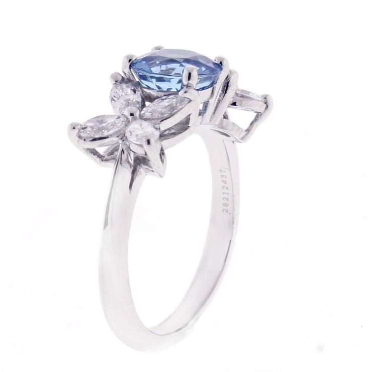Marquise diamonds blaze like stars that light the night. The Victoria setting by Tiffany & Co.makes the perfect setting for this round  Santa Maria  deep blue Aquamarine. The aquamarine has a 7mm diameter with a calculated weight of 1.20 carat. The