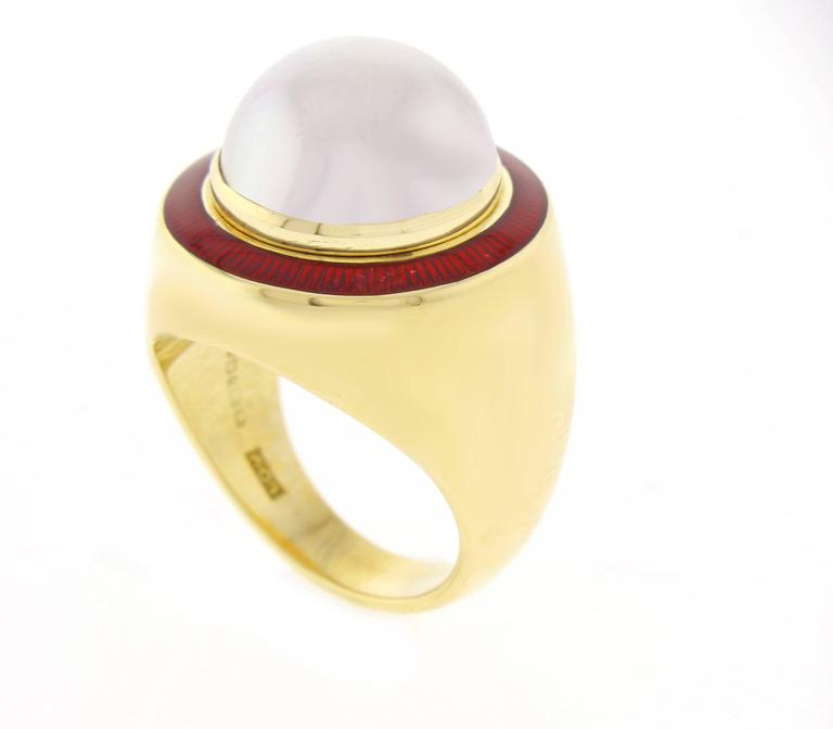 Leo De Vroomen is world renowned for his vividly colored enameling and stunning designs. This ring features a 15mm mabé pear  framed by French red enamel. The 18 karat gold ring bears the official assay mark of London.  Size 7