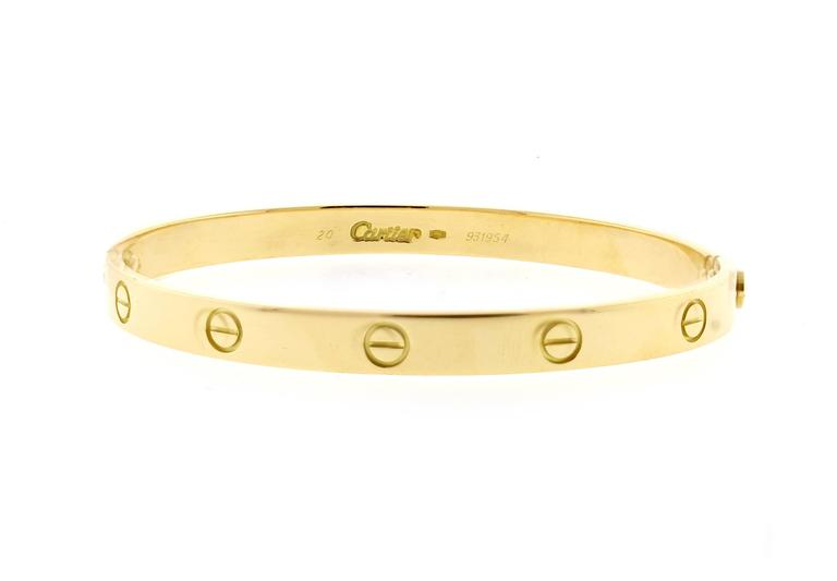 18 karat yellow gold Cartier Love bracelet. The love bracelet remains an iconic symbol of love that transcends convention. Original design, type 1, Size 20,  screwdriver, Cartier box.   Certificate of Authenticity, sales receipt, Polished to like