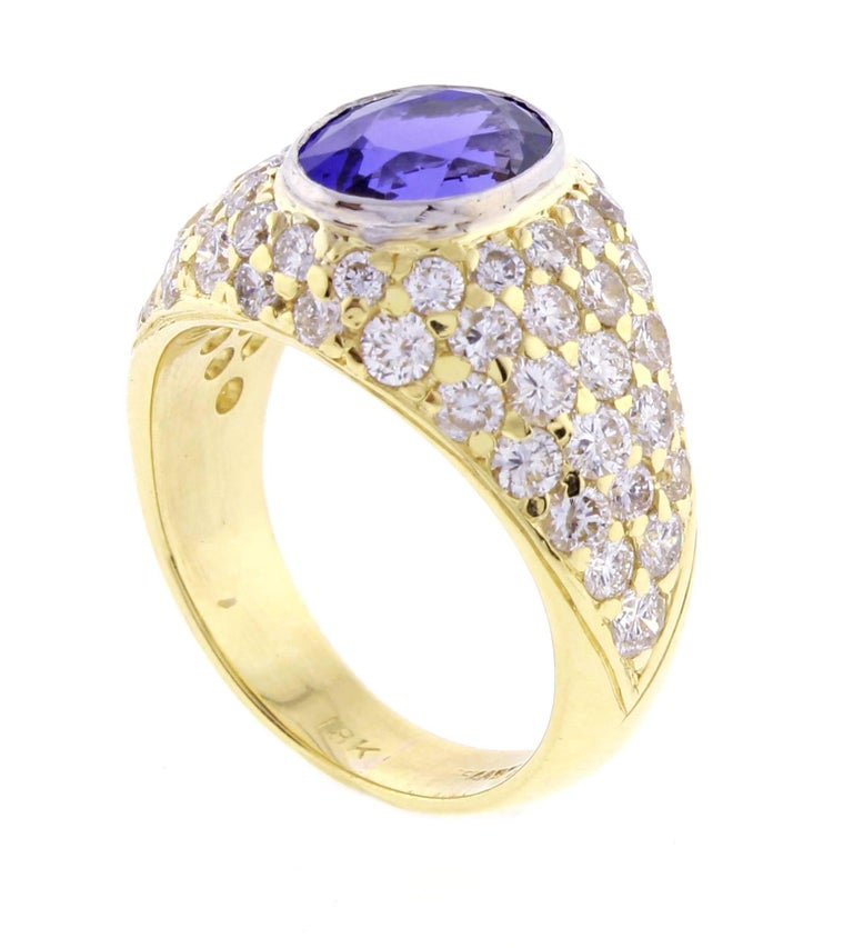 From Tiffany & Co., this spectacular tanzanite and diamond 18 karat gold ring. The center oval tanzanite weighs approximately 2.5 carats. The 63 brilliant diamonds weighs approximately 2.80 carats. The tanzanite has been polished and is in like new