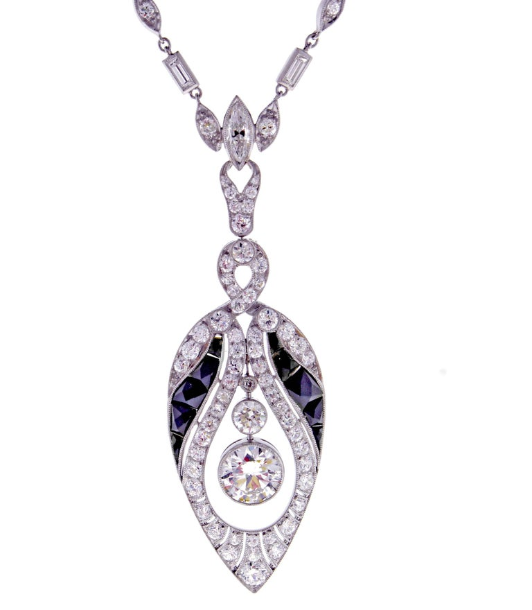 An exceptional example of Art Deco style, this sautoir necklace exemplifies the grace and elegance of the 1920s. The platinum necklace boasts over 6 carats of round, baguette and marquise cut diamonds. The center old European cut diamonds weighs