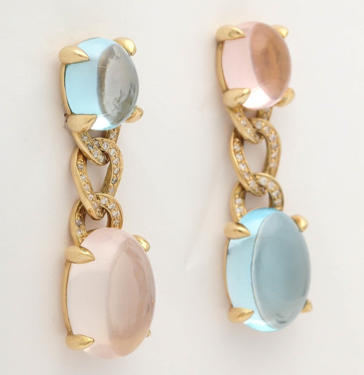 18KT yellow gold earrings with blue topaz, rose quartz and white diamonds.
