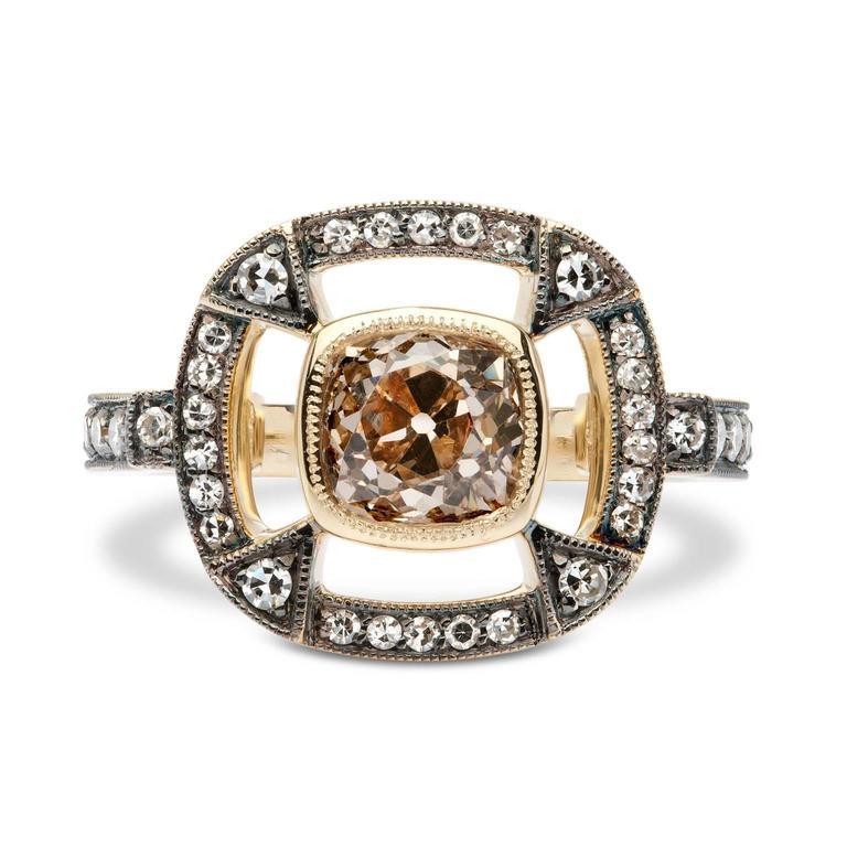 1.51 Carat Orange Brown Cushion Cut Diamond Gold Halo Ring  An impressive 1.51 carat Fancy Orange Brown Cognac diamond with a fashionable cushion cut is beautifully set in a mill grained halo of 18 karat yellow gold containing 44 Single Cut Diamonds