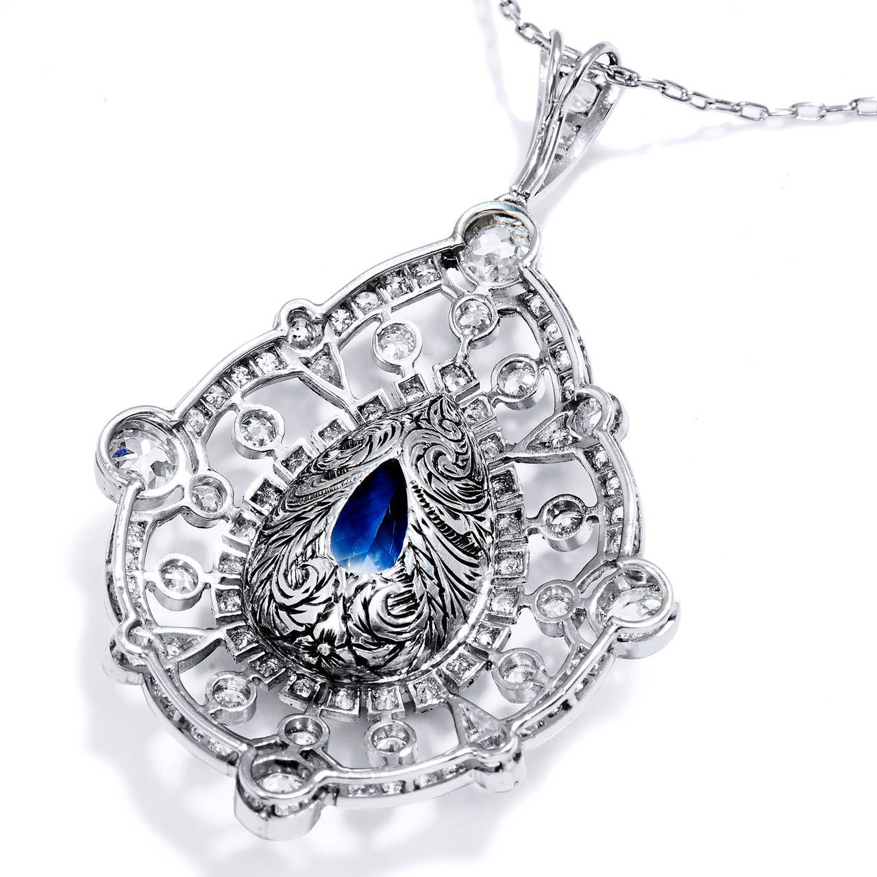 A.G.L. Certified 9.83 Carat Pear Shaped Sapphire & 3 ct Diamond Platinum Pendant In Excellent Condition For Sale In Miami, FL