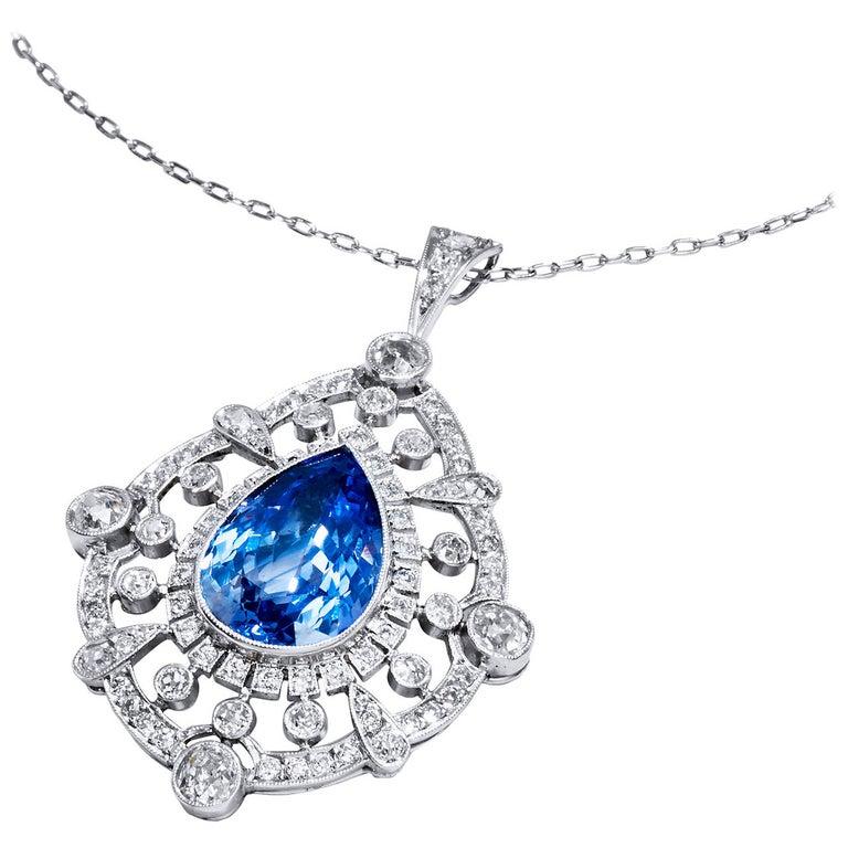A.G.L. Certified 9.83 Carat Pear Shaped Sapphire & 3 ct Diamond Platinum Pendant For Sale