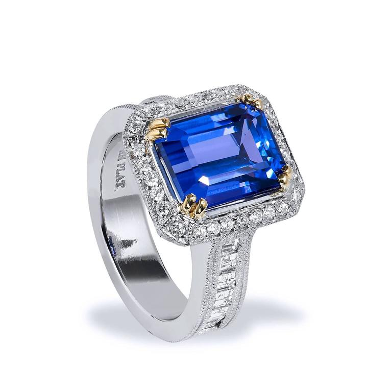 A captivating 4.91ct deep purplish blue tanzanite stone takes center stage of this handmade Art Deco Style ring. Meticulously crafted in platinum and 18kt yellow gold, the luscious center stone is cradled by .72ct H-VS carre cut diamonds on either