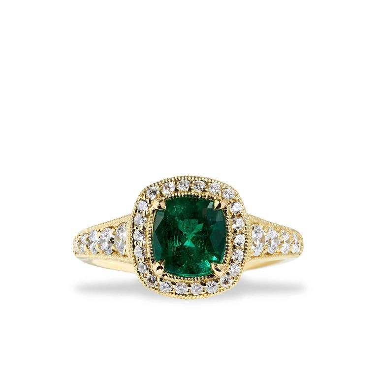 Unique is the true definition of this piece. A one-of-a- kind, showstopping design, this ring is crafted in 18kt yellow gold and features a GIA certified no treatment Emerald. The deep green hue of the center stone pierces the eye with color and is