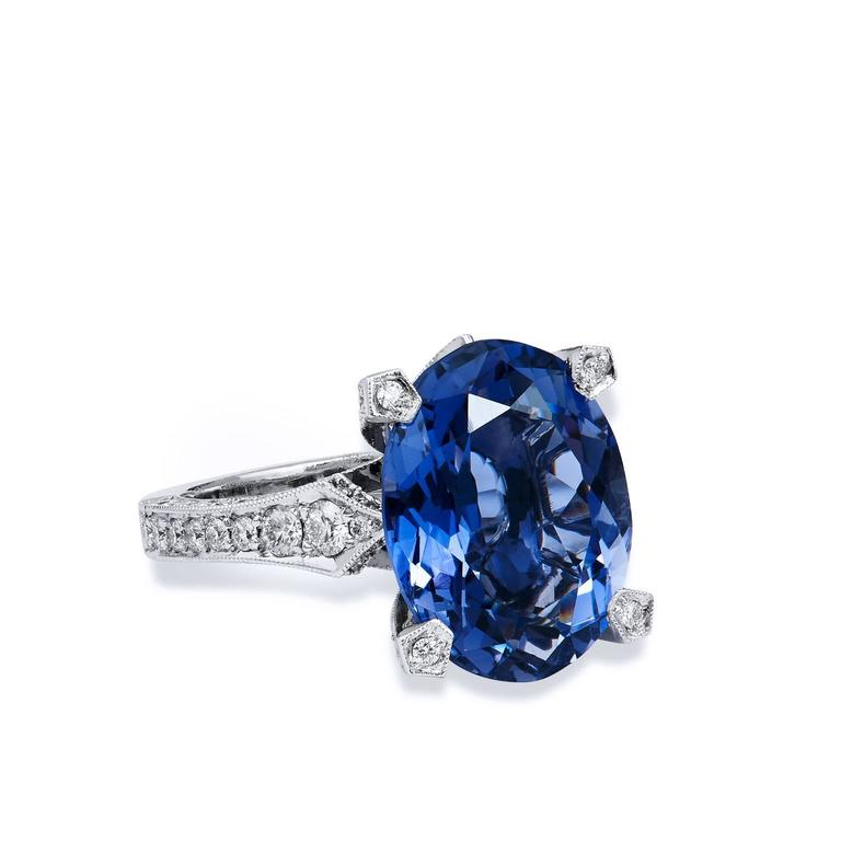 7.89 Carat Iolite and Diamond 18 karat White Gold Ring Size 6.75  Crafted in 18 karat white gold, this ring features a 7.98 carat lolite center gemstone. Trailing the shank are 156 pieces of diamonds graded H VS 1 weighing 1.49 carat total. This
