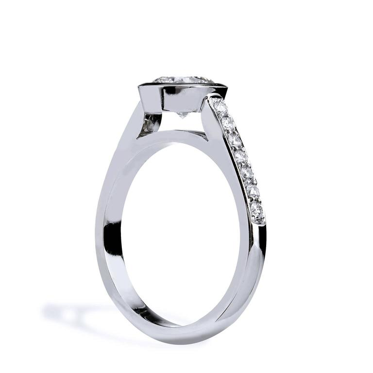 Women's GIA Certified 1.01 Carat Diamond and Pave Bezel Set Platinum Engagement Ring For Sale