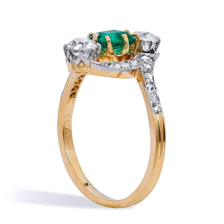 Art Deco Estate Emerald Diamond 3 Stone with Pave Gold Platinum Bypass Ring  This beautiful and elegant ring was made with excellent craftsmanship of the old world. The top of the ring is created in platinum which make the diamonds and emeralds pop