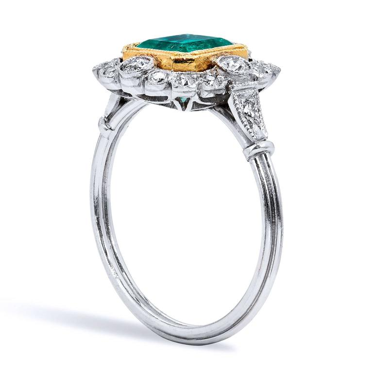 GIA CERTIFIED Art Deco Inspired 1.60 Carat Colombian Emerald Diamond Yellow Gold Platinum Ring  This beautiful creation is Art Deco inspired made of platinum and 18 karat yellow gold.  It features a 1.60 carat Colombian Emerald set at center. For