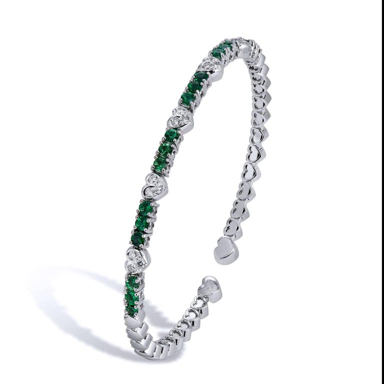 Enjoy this previously loved 18 karat white gold bracelet featuring eighteen pieces of green tsavorite and 0.22 carat of pave set diamond (F/G/SI1). Let a little green envy inspire your style.
