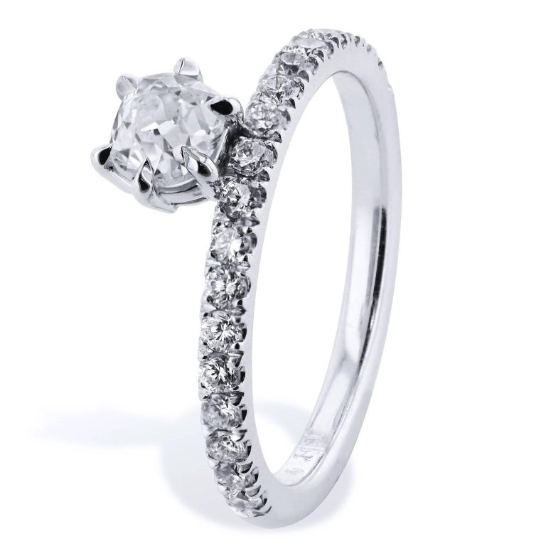 H&H 0.61 Carat Solitaire Antique Cushion Cut Diamond with Pave Band Ring  This is a handmade, one of a kind ring created by H&H Jewels.    This beautiful ring features a 0.61 carat Antique Cushion Cut diamond that is set at center with six prongs.