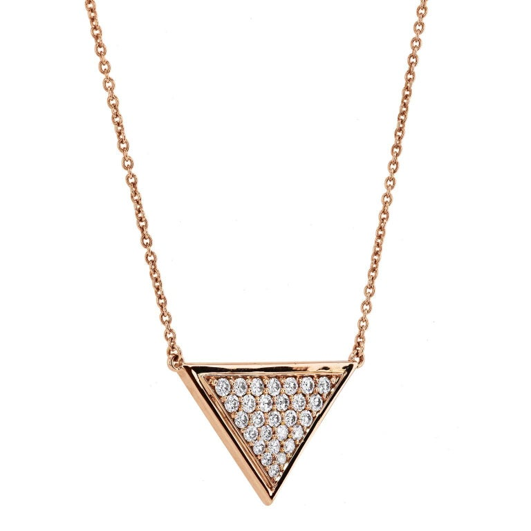 1.12 carat of pave -set diamond are arranged in a triangle orientation in the 18 karat rose gold pendant necklace.
