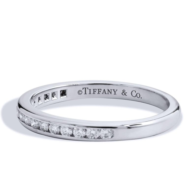 Estate Tiffany & Co. 0.17 Carat Diamond and Platinum Eternity Band Ring Size 5.5  Enjoy this previously loved Tiffany & Co. band ring featuring 17 channel set diamonds with a total weight of 0.17 carat and affixed to a 2 millimeter platinum band