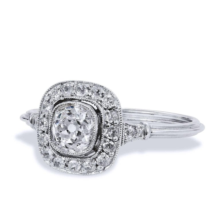 Art Deco Style Old Mine Cut 0.73 Carat Diamond Platinum Halo Engagement Ring  Create a shimmer and shine that she will adore with this Art Deco-style platinum engagement ring. Eighteen pieces of pave set diamonds in halo, with a total weight of 0.23