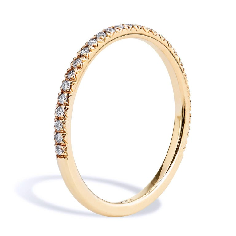 18 Karat Yellow Gold Band Ring with 0.14 Carats Total Weight of Diamonds  This diamond band ring features twenty-seven diamonds that are pave set with a total weight of 0.14 carat (G/H/VS).  These beautiful diamonds are affixed to a 1.50 mm 18 karat