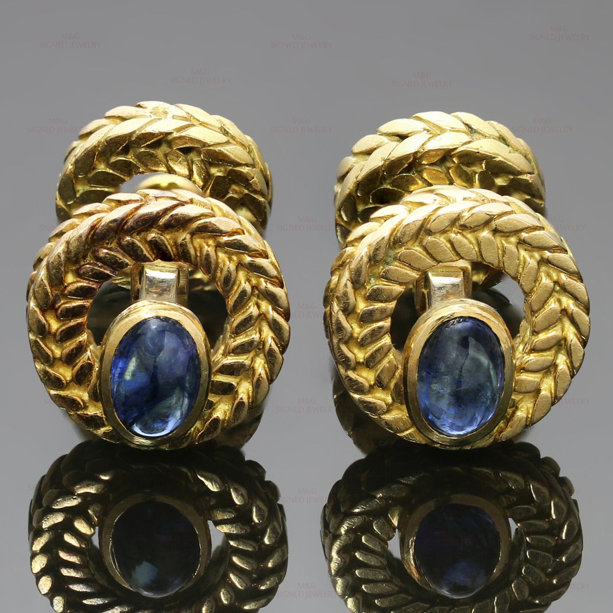 These classic Van Cleef & Arpels cufflinks are crafted in 18k yellow gold and set with 2 oval and 2 round blue cabochon sapphires of an estimated 3.0 carats. Made in France circa 1960s. Measurements: 0.55