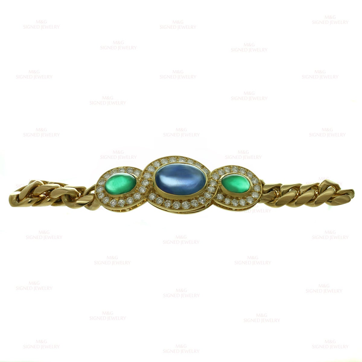 This fabulous Bulgari bracelet is made in 18k yellow gold and set with a blue oval cabochon sapphire measuring 9.0mm x 12.00mm and weighing an estimated 10.5 carats and 2 green oval cabochon emeralds measuring 5.5mm x 7.00mm and weighing an