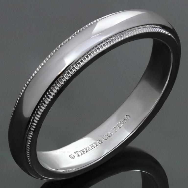 "This classic men's Tiffany wedding band ring features a classic milgrain design crafted in platinum. Made in United States circa 2010s. Measurements: 0.15"" (4mm) width. The ring size is 10 - EU 62. Non-resizable."