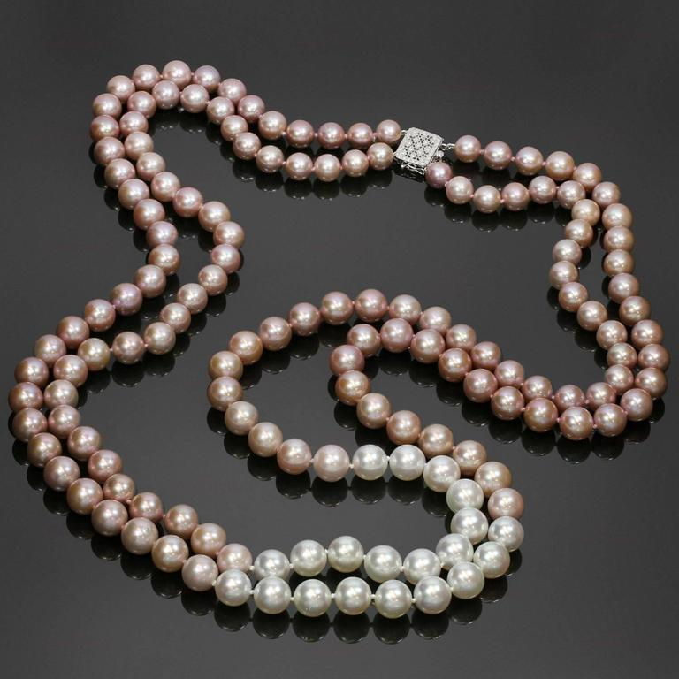 This gorgeous double-strand opera necklace features a stunning selection of South Sea Cultured Pearls and Freshwater Cultured Pearls - 155 very shiny pearls with high luster and intense even pink color. The necklace is completed with a sparkling