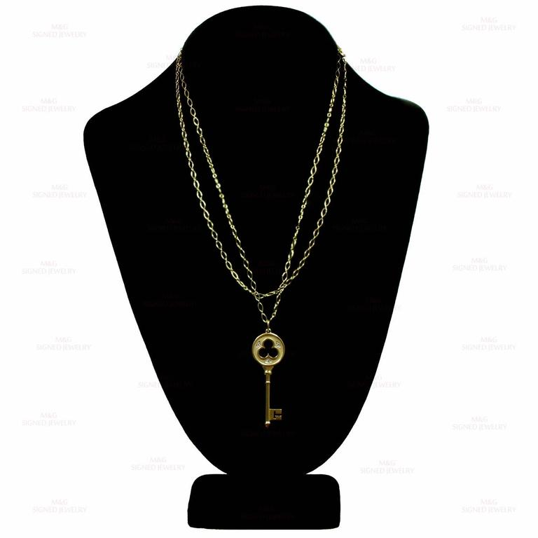 Tiffany & Co. Clover Key Diamond Yellow Gold Necklace In Excellent Condition For Sale In New York, NY
