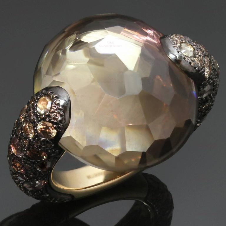 "This stunning cocktail ring from Pomellato's Sabbia collection is crafted in 18k yellow gold and set with a faceted round smoky topaz and champagne diamonds. Made in Italy circa 2010s. Measurements: 0.82"" (21mm) width. The ring size is 6.75 -"