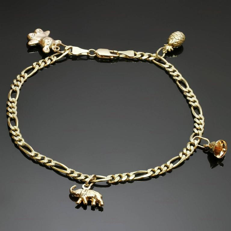 This Ankle Bracelet Is Crafted In 14k Yellow Gold And Features 4 Charms An Elephant