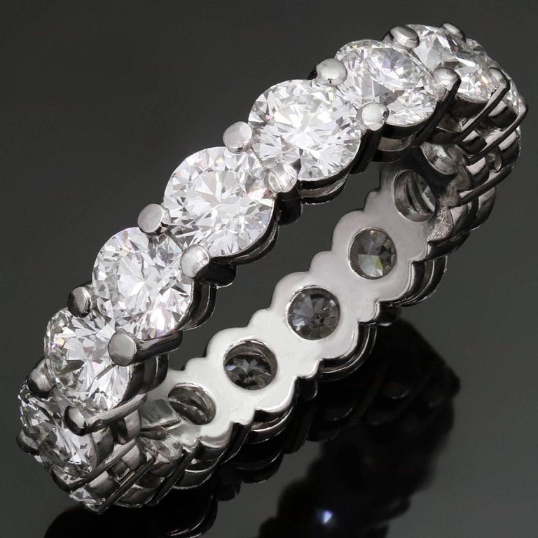 This magnificent Tiffany 3.0mm band ring is crafted in platinum and features a full circle of 16 round brilliant-cut diamonds of an estimated 5.25 carats. Made in United States circa 2000s. Measurements: 0.15