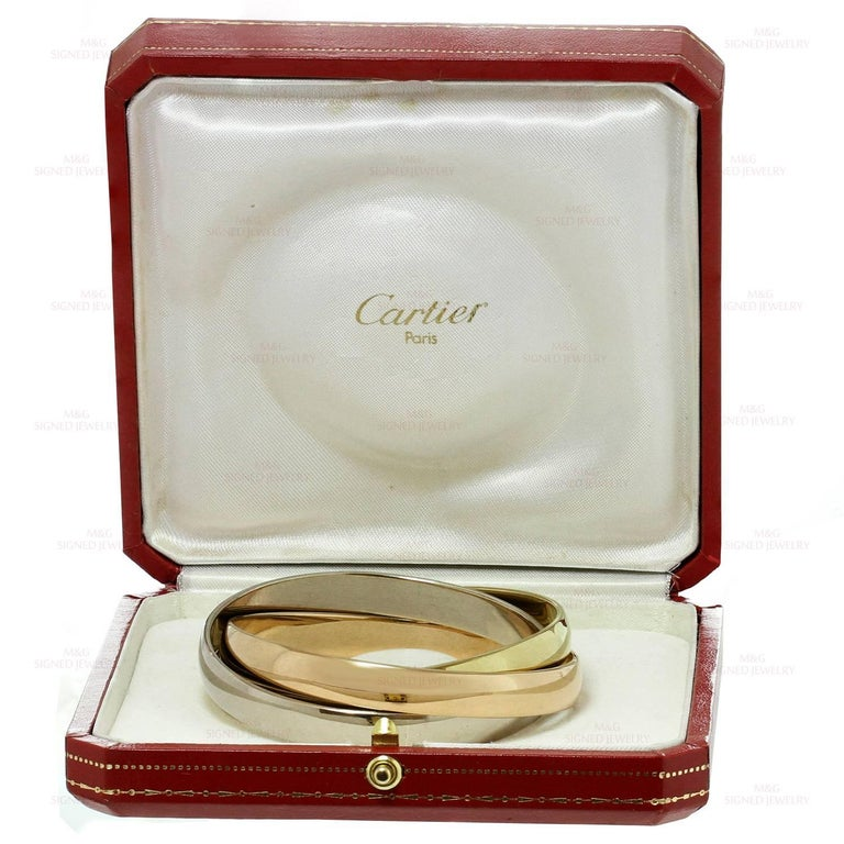 Cartier Trinity Tri-Gold Large Bangle Bracelet In As New Condition For Sale In New York, NY