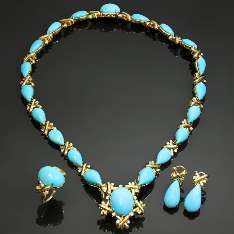 This magnificent vintage jewelry set is crafted in 18k yellow gold and set with a 61 brilliant-cut round diamonds of an estimated 3.75 carats and oval and pear-shaped turquoise stones - bright turquoise blue to slightly greenish blue, light matrix