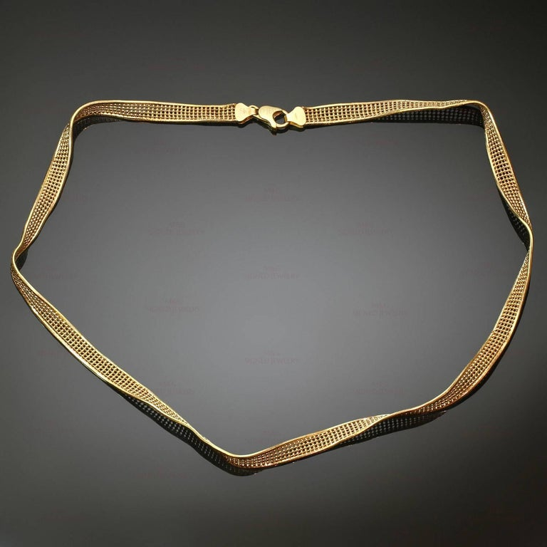 This classic necklace features a twisted mesh design crafted in 18k yellow gold. Made in Italy circa 1990s. Measurements: 0.23