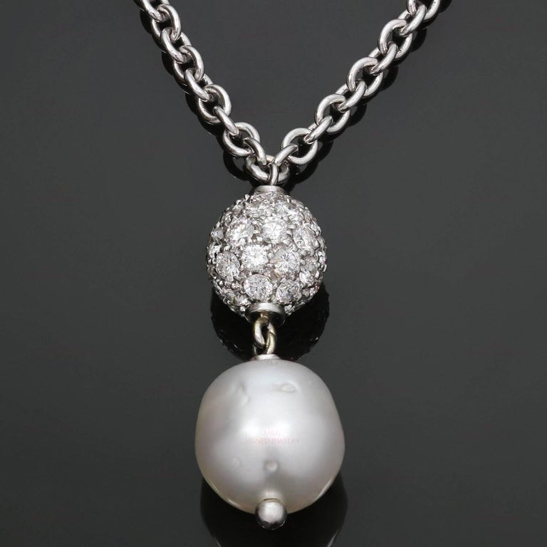 0fcabdbbe This elegant and timeless necklace is made in 18k white gold and features a  beautiful 11.0