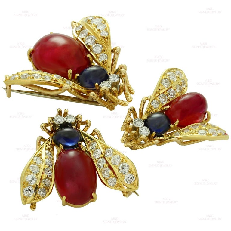 Van Cleef & Arpels Trio Set Ruby Sapphire Diamond Yellow Gold Pin Brooches In Fair Condition For Sale In New York, NY