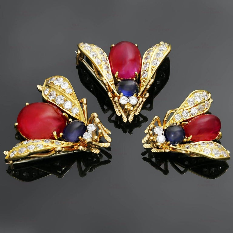 This terrific trio of Van Cleef & Arpels fly-shaped brooches are crafted in 18k yellow gold and set with full, single, and European-cut diamonds weighing an estimated 1.70 carats, accented with cabochon oval rubies and round blue sapphires. Two