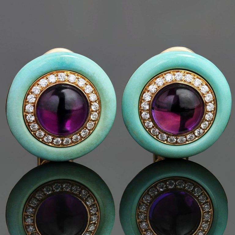 These gorgeous lever-back Bulgari earrings are crafted in 18k yellow gold and beautifully set with round cabochon amethysts encircled with a row of sparkling brilliant-cut round diamonds and a band of natural turquoise. Made in Italy circa 2000s.